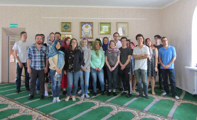 Students visit a mosque and speak with the local imam.