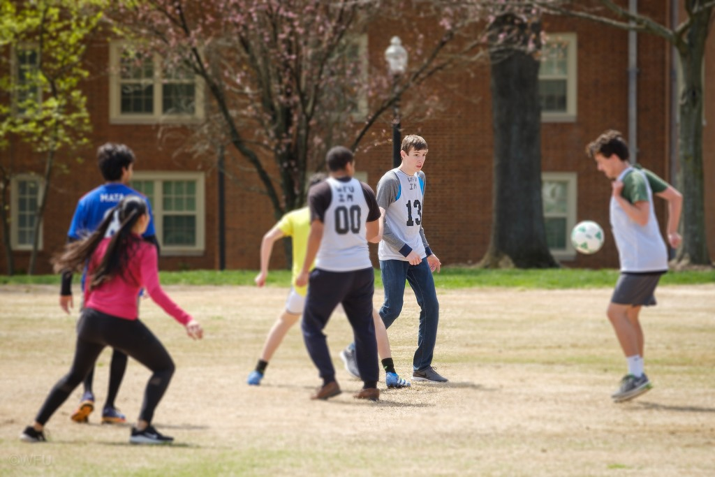 Students playing a soccer game